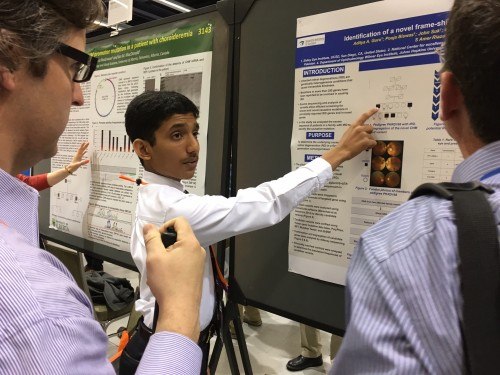 Aditya A. Guru explaining his poster